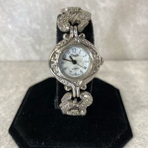 Woman's Vintage vintage dolphin silver watch